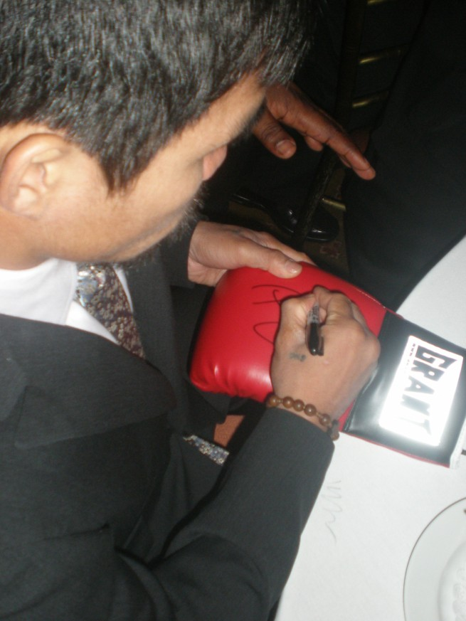 Manny signing Grant gloves for www.substancecollectables.com