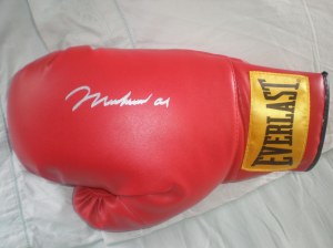 Autographed Muhammad Ali Boxing Glove with Photo at www.substancecollectables.com